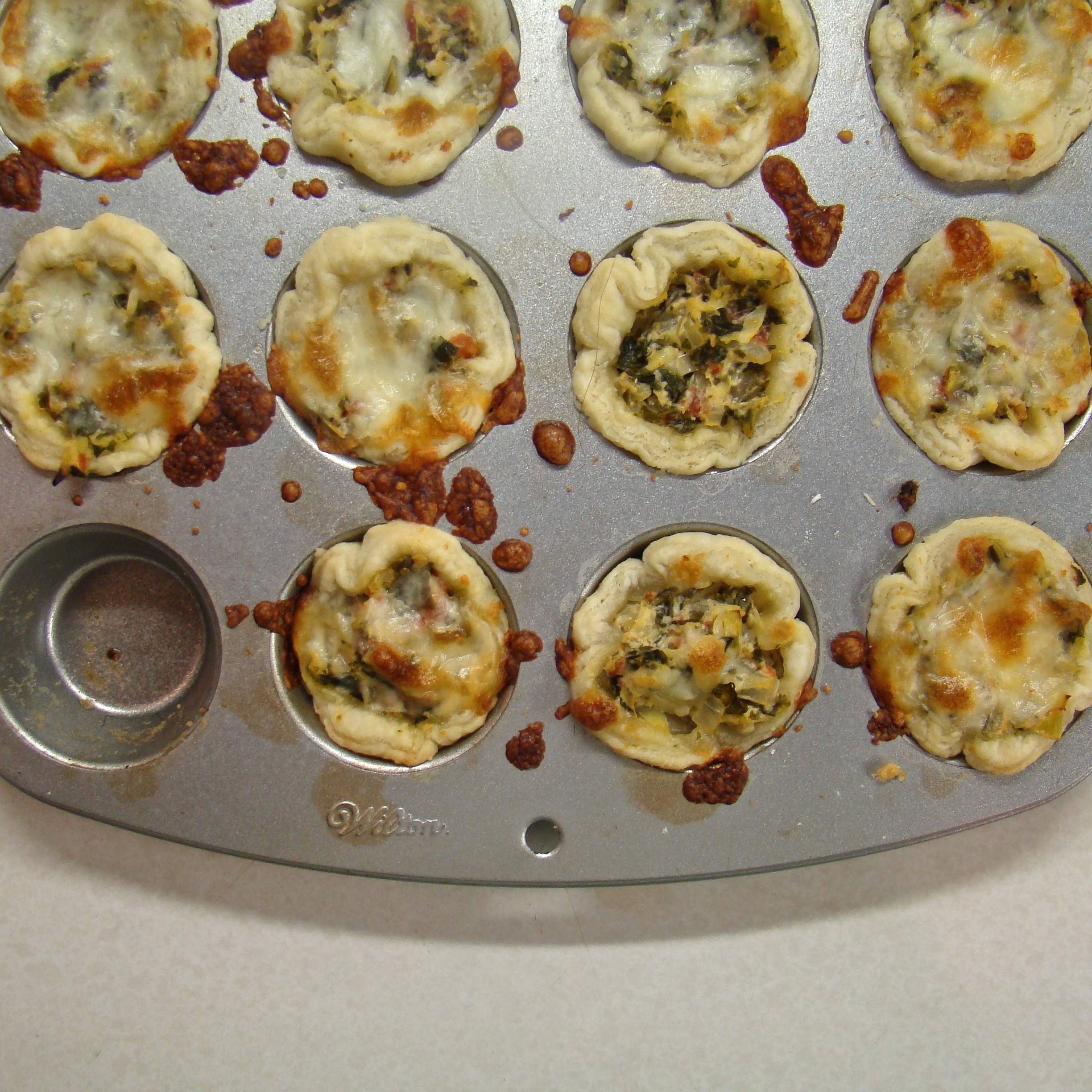 Caramelized Onion, Kale, and Artichoke Tartlets