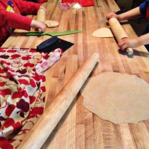 kids rolling tortillas