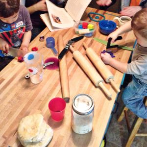 playing with play-doh at the kitchen island