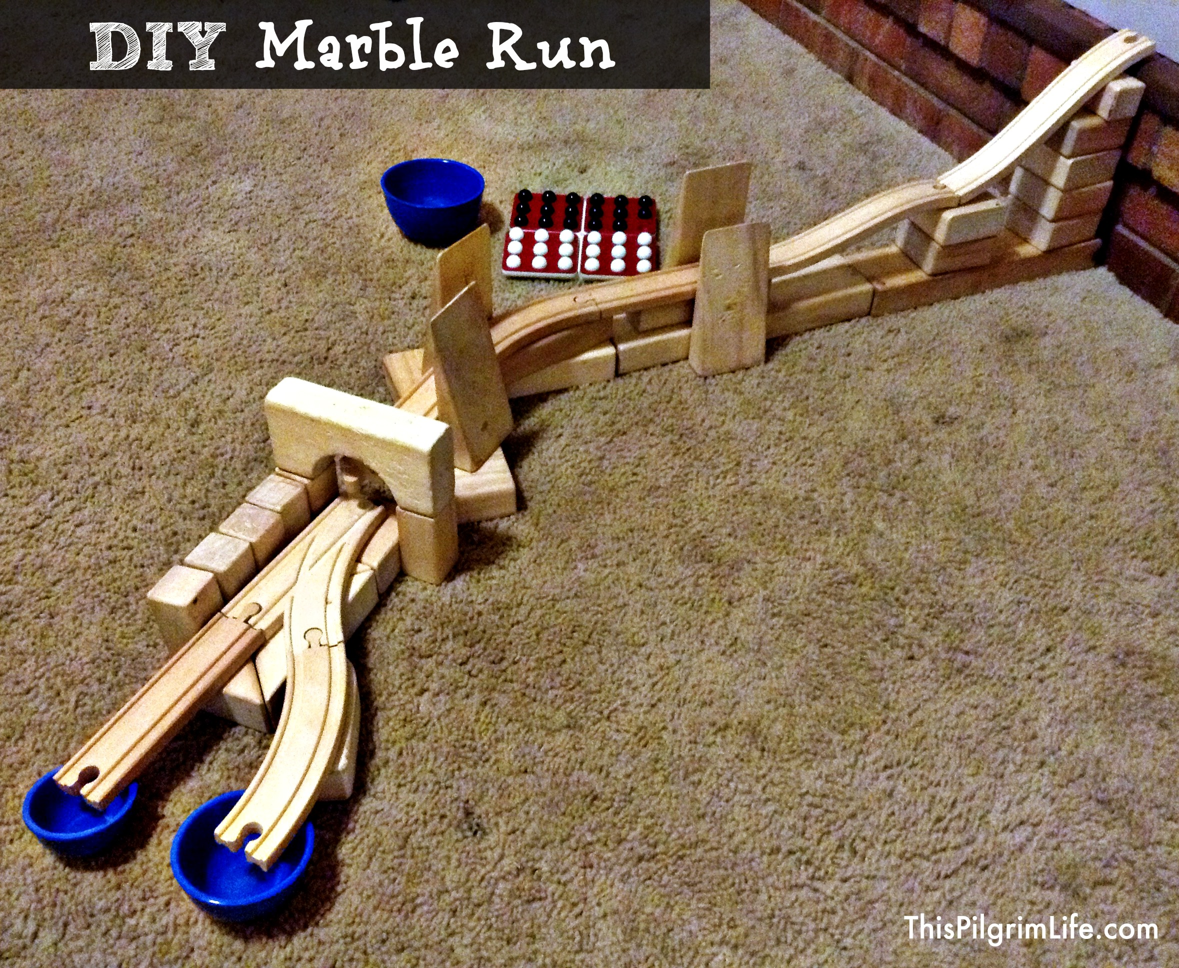 Make a marble run with wooden train tracks and blocks!