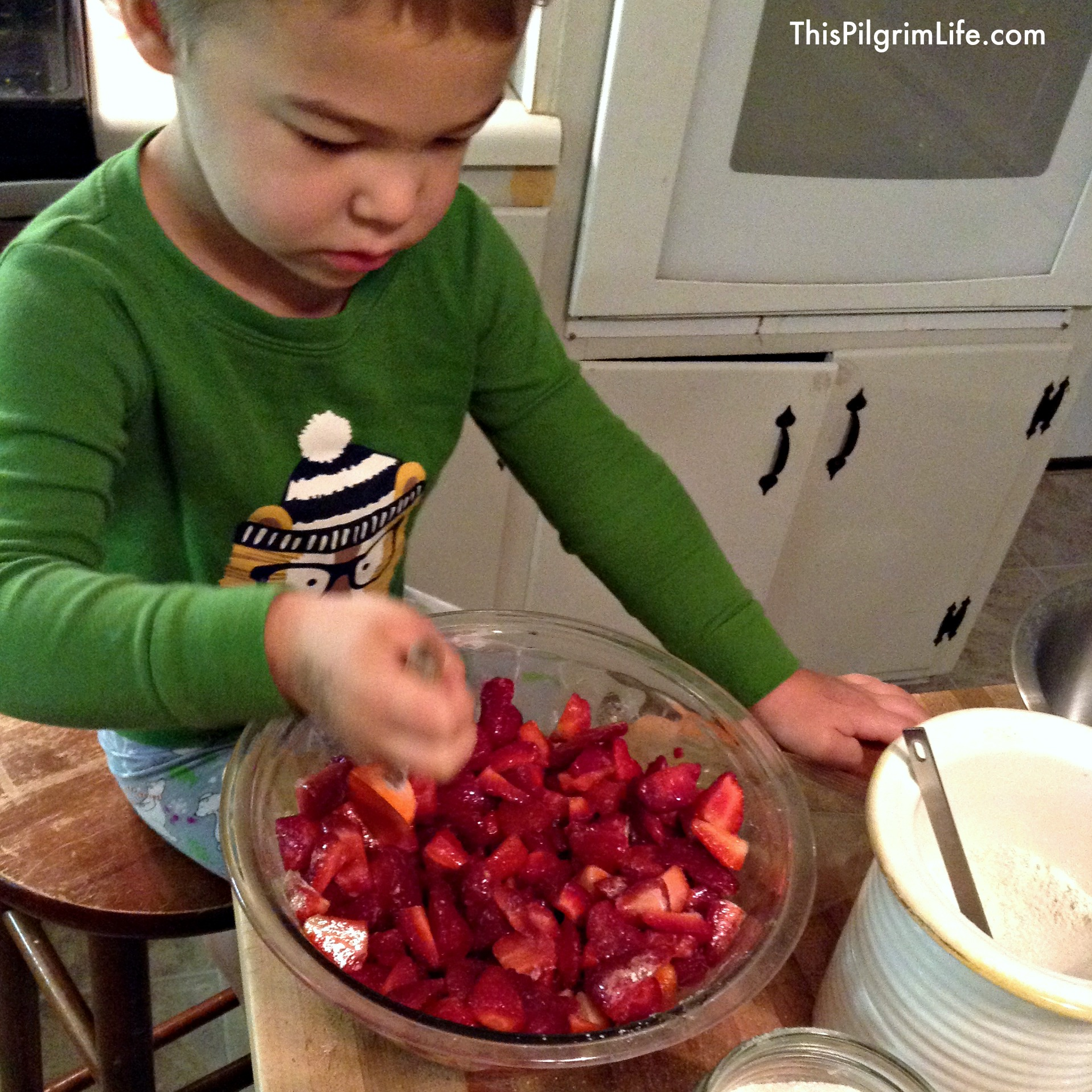Helping mama to make a simple strawberry crisp for church.