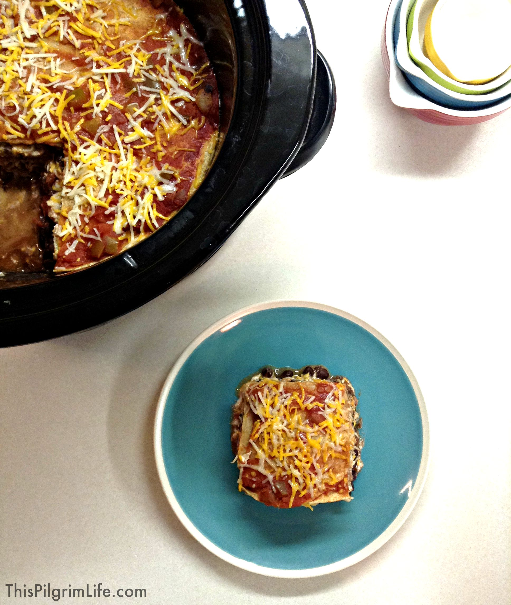 Such a simple and delicious recipe for Mexican lasagna made in the crockpot. Perfect for potlucks and sharing with friends!