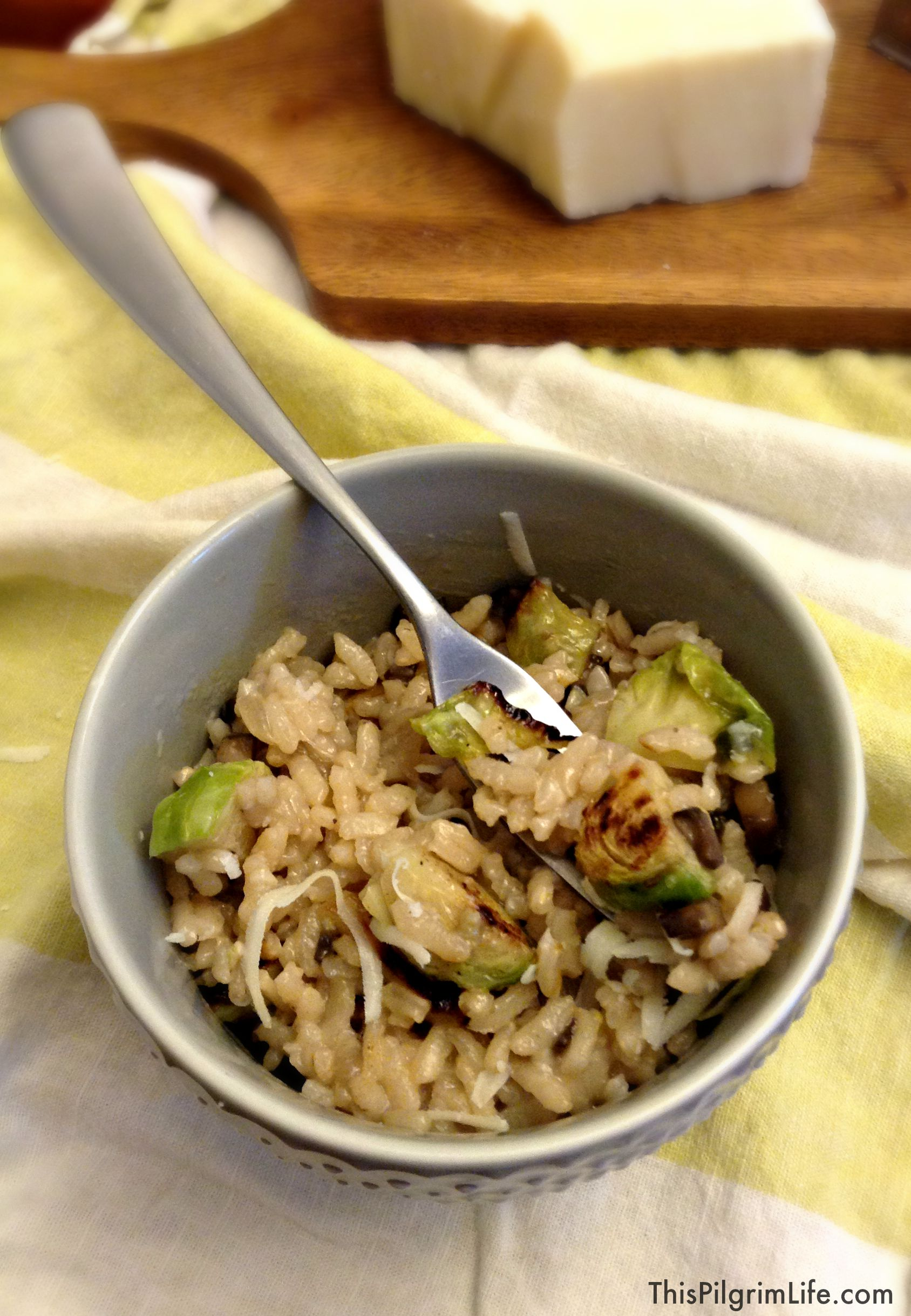 A bowl of creamy mushroom risotto with roasted Brussel sprouts mixed in-- easy, inexpensive, and ready in about thirty minutes. COMFORT FOOD!