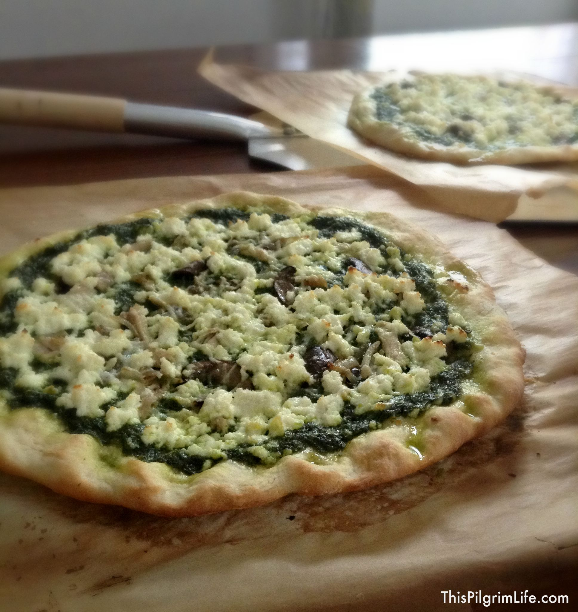 I LOVE homemade pizza, especially when it can be made quickly with ingredients I already have on hand like this pesto pizza!
