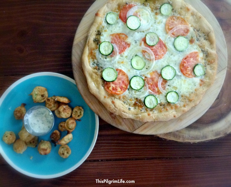 Garden Pizza :: simple thin crust pizza dough + EVOO mixed with salt, pepper, garlic powder, and oregano + just enough mozzarella to cover the oil + THIN slices of onion, zucchini, and tomato + parmesan cheese ::