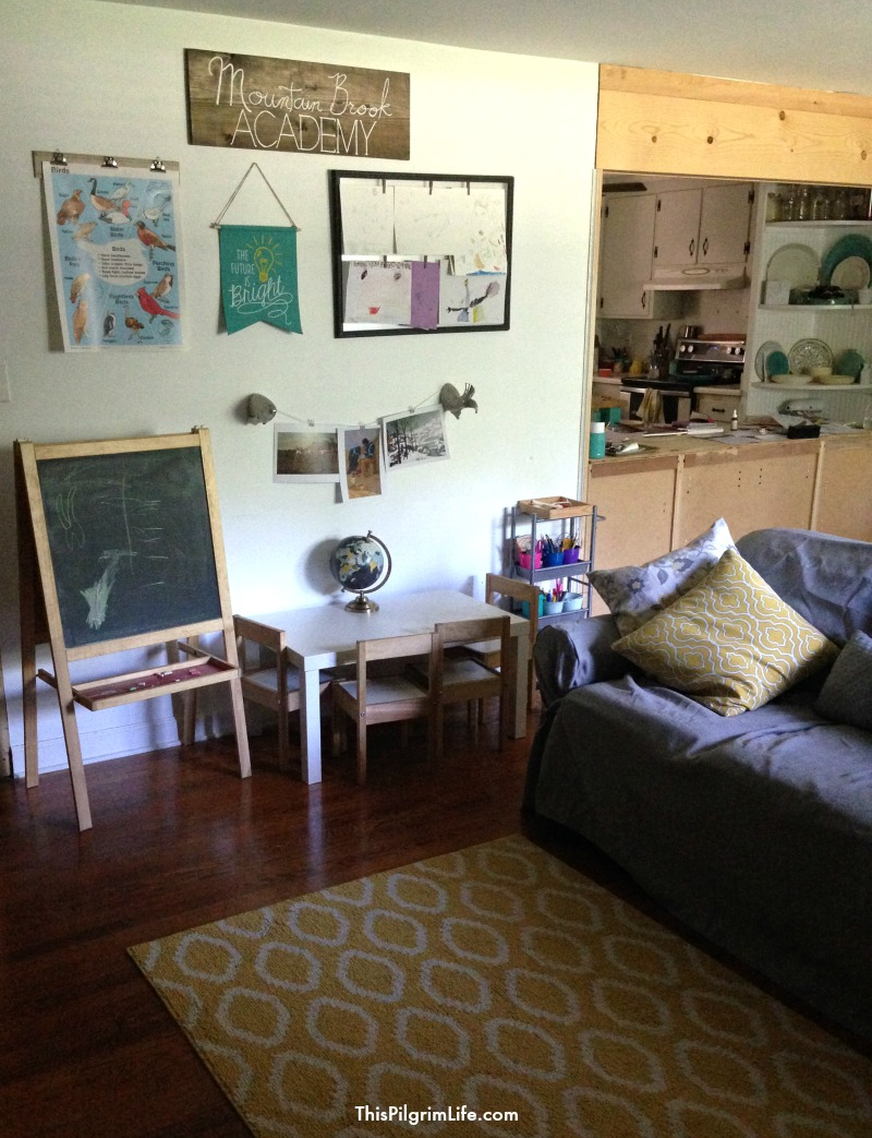 You don't have to have a schoolroom in your house to homeschool. And homeschooling doesn't mean your house has to look like a classroom. Here's how we set up an uncluttered but functional school area in our home's common room.