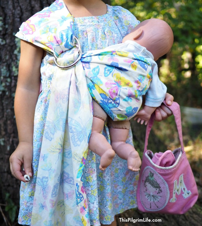 Follow this SUPER SIMPLE tutorial to make a ring sling for your baby-loving child, or enter to win one below!