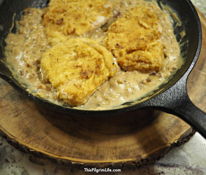 This meal is amazingly delicious and seems like it belongs in a restaurant, but these pan fried pork chops with onion bacon gravy are surprisingly simple to make at home!