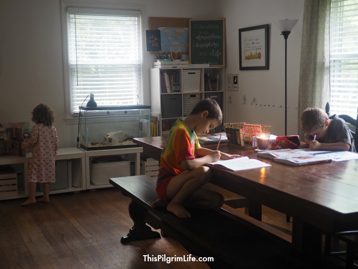 It's possible to create an organized homeschool space in a common room without it looking like a classroom! Here is how this mom makes her dining room into a functional homeschool space while keeping the room relaxing and inviting!