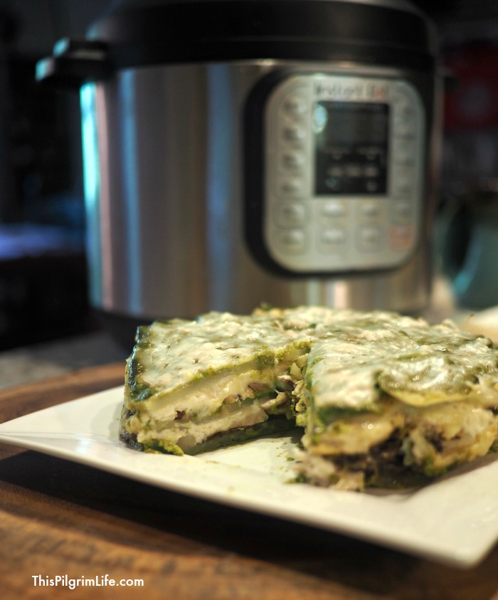 Layers of savory pesto sauce, chicken and mushrooms, creamy cheese, and potatoes... all cooked quickly and conveniently in your Instant Pot! This Instant Pot strata is one you'll come back to again and again!