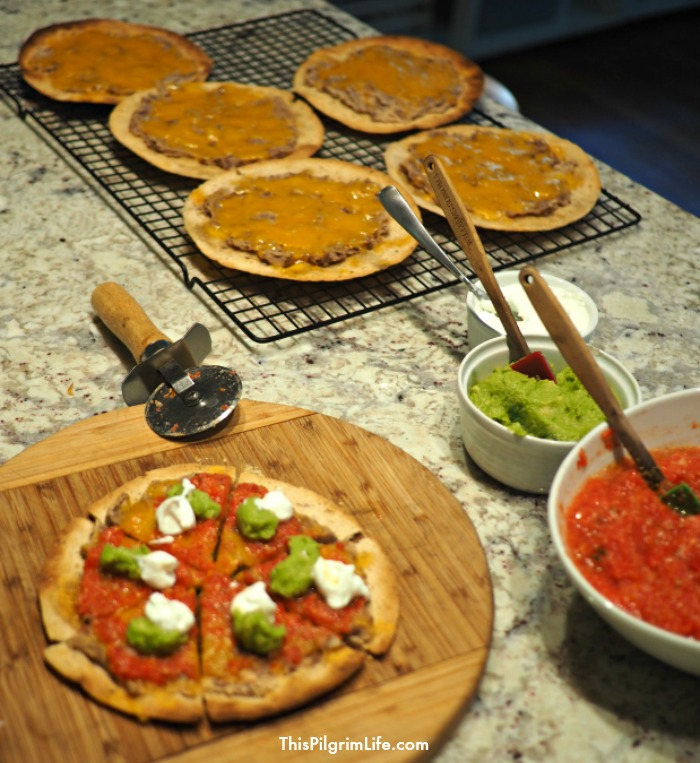 These easy tortilla pizzas make a quick and delicious meal idea that is both frugal and family friendly!