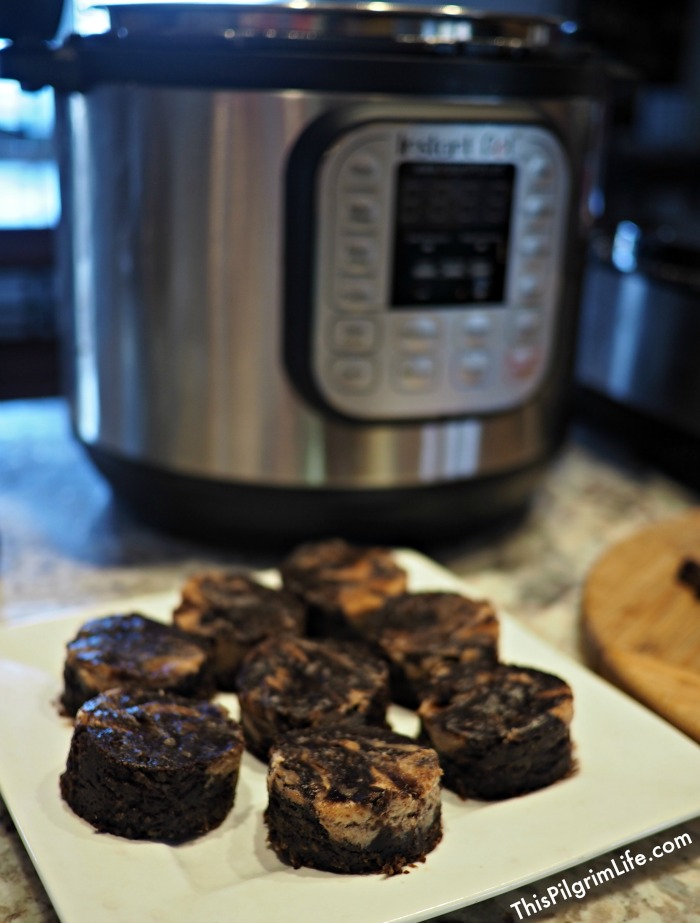 A delicious, healthier twist on Instant Pot brownies! Rich, chocolate brownies with a hint of coconut and swirls of almond butter. Conveniently and easily cooked in your Instant Pot.