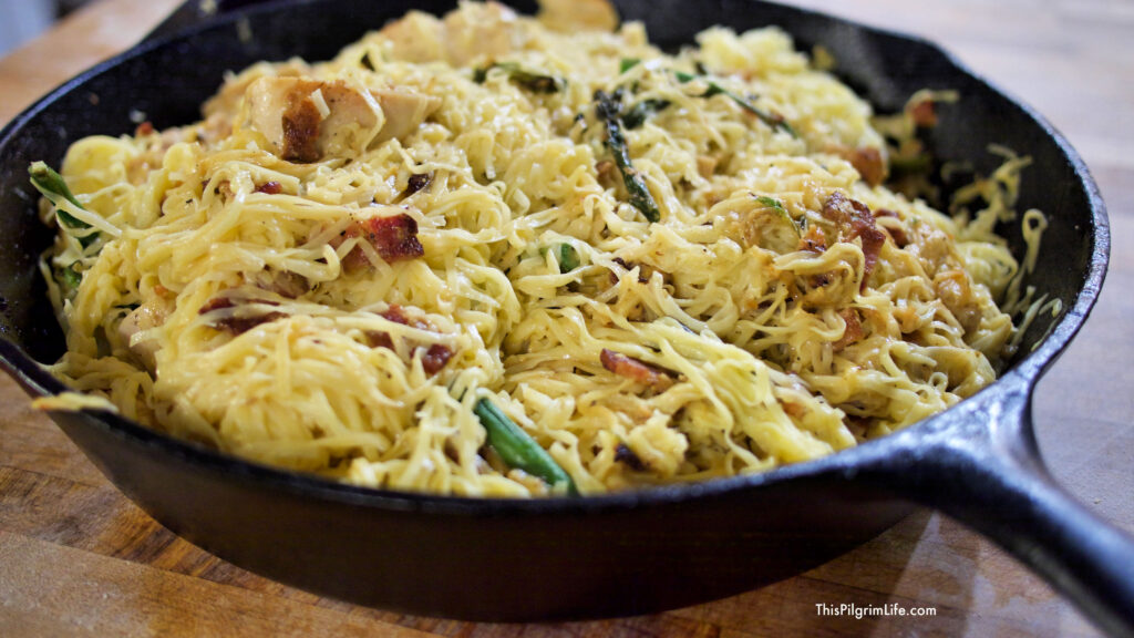 Silky noodles, salty bacon, tender chicken, and crispy asparagus complement each other perfectly in this easy skillet chicken carbonara! You won't believe how simple the recipe is and how quickly it comes together!
