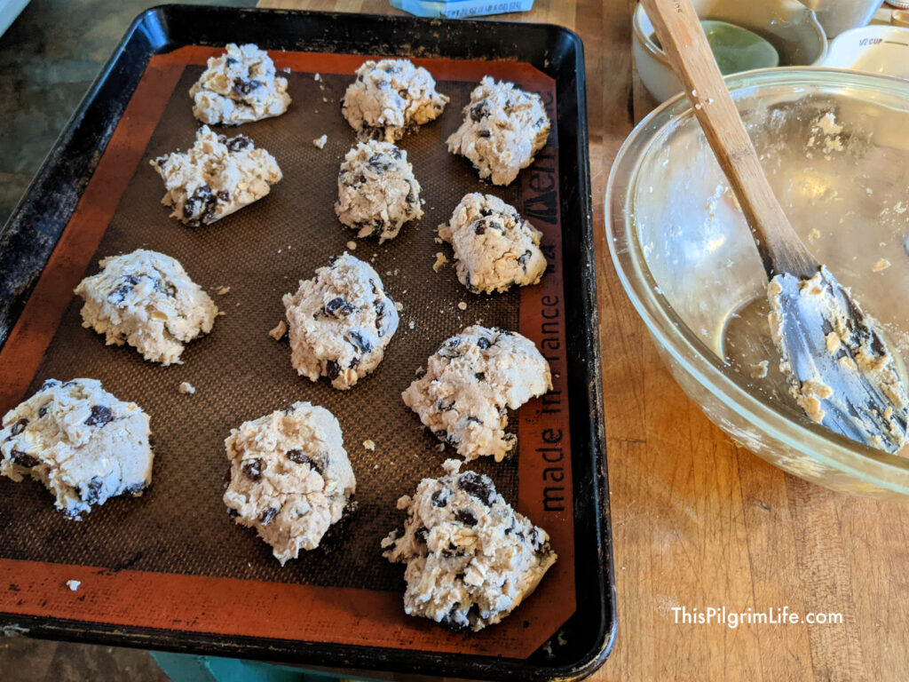 Portion the dough into a dozen biscuits on a baking sheet lined with a silicon mat.