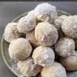 Our family recipe for Russian tea cakes-- tender, round cookies rolled in powdered sugar-- makes an appearance every Christmas season. These cookies are easy to make and so tasty!