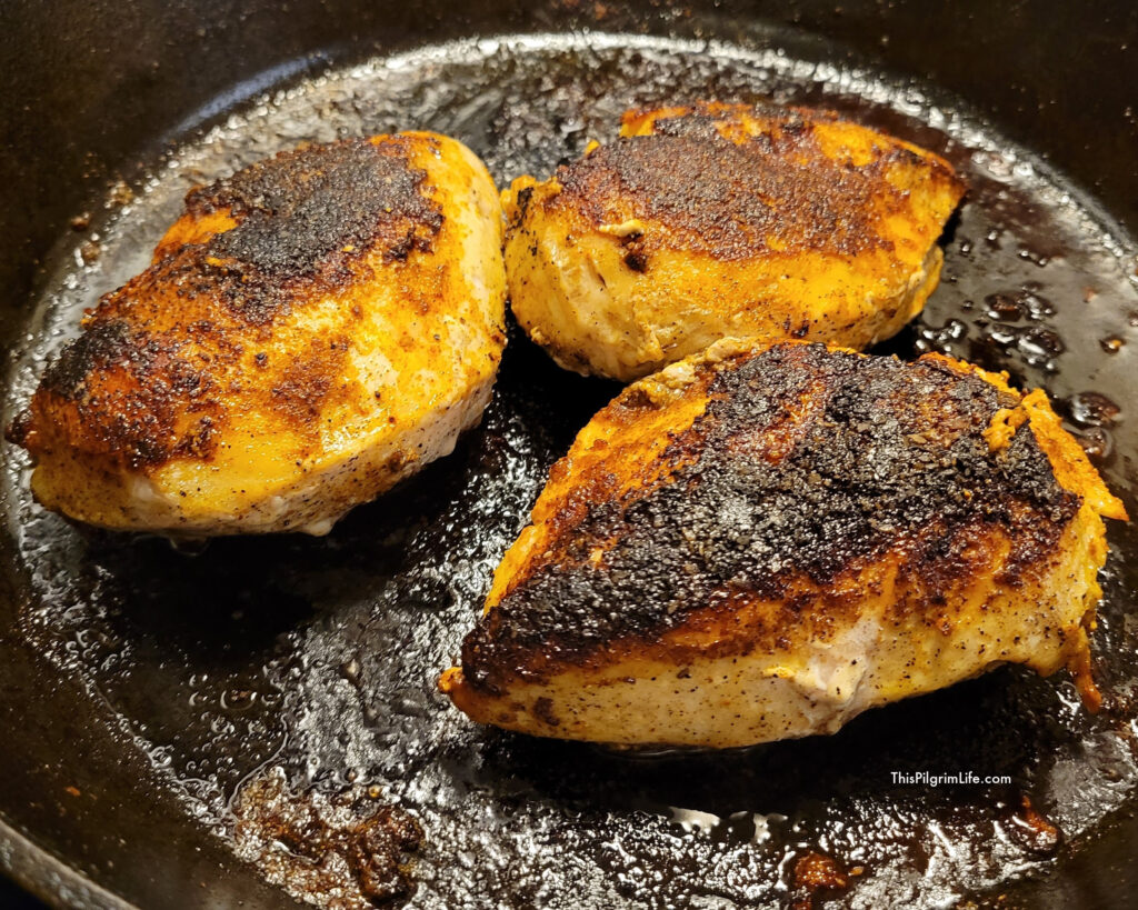 The finished blackened chicken in the pan.